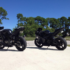 My Hyosung.(left) Bought it in Key West on a whim, to teach people on. Not bad looking for a 250
