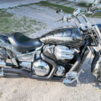 03 vtx custom. 2200cc stroked motor, predator theme graphics, air ride, billet front end, 240 tire