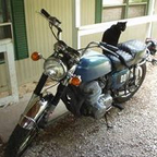 My former cat, Magenta, on my motorcycle...a 1972 Honda CBR 750, in Southwest Missouri 2002