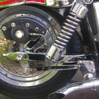 I fitted a polished fat boy wheel on the back , lowered swing arm drops the bike bout 2 ""