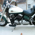 "My baby!  This pretty bike with the huge gas tank and the cushy ""mustang seat "" won my heart."