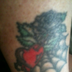 A black rose, daggering a heart , dripping blood in a spider web..Lol<br />I got this in \'91.. long stor ...