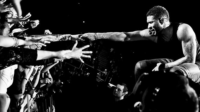 usher in concert with fans crazy